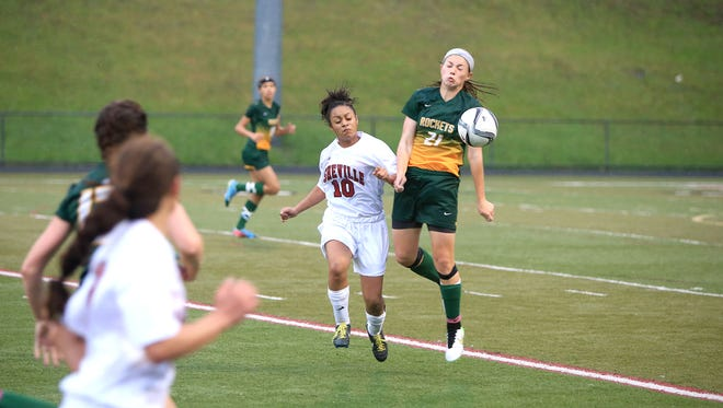 Asheville High's Antares Lance (10) and Makayla Ballenger battle for a ball Friday at Asheville.