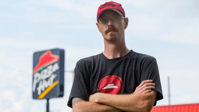 William Hotop fended off an armed robber breaking into the Pizza Hut he worked at in a gunfight early in the morning of Sept. 12.