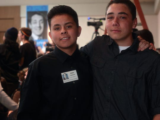 Aiden Stockman (left) and a Yucca Valley classmate attend the Harvey Milk Diversity Breakfast on Friday in Palm Springs.