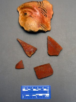 Sherds of Aztec tradition red filmed pottery found