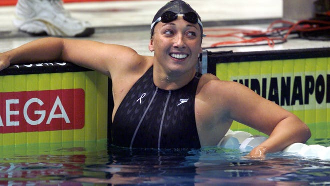 Amy Van Dyken smiles after swimming in the  womens 100-meter freestyle prelims at the 2000 U.S. Olympic swimming trials.