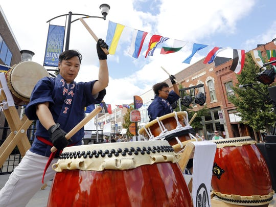 Kiyo Matsuyama pounds out a rhythm on a Japanese Taiko drum while performing at the 2013 World Food & Music Festival in Des Moines.