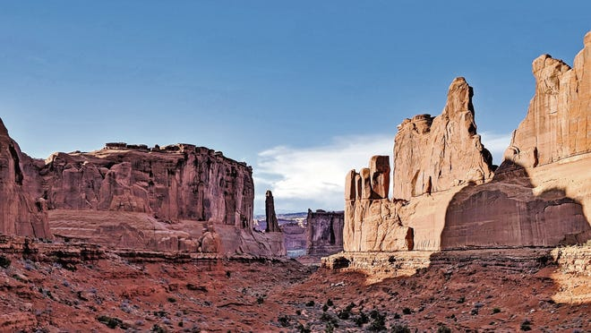 Park Avenue and Courthouse Towers are among 2,000 natural formations in Arches National Park.