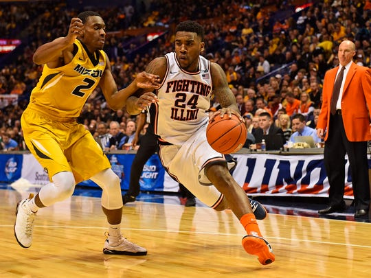 Fighting Illini guard Rayvonte Rice (24) dribbles the ball around Missouri guard Deuce Bello (2) during the Illinois' win in the Bragging Rights game.