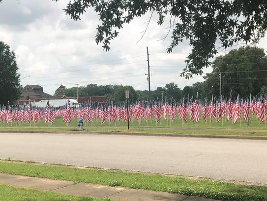 Flags fill the lawn of the First Cumberland Presbyterian
