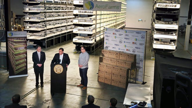 New Jersey Gov. Chris Christie, center at podium, addresses in March a gathering at AeroFarms, a vertical farming operation in Newark