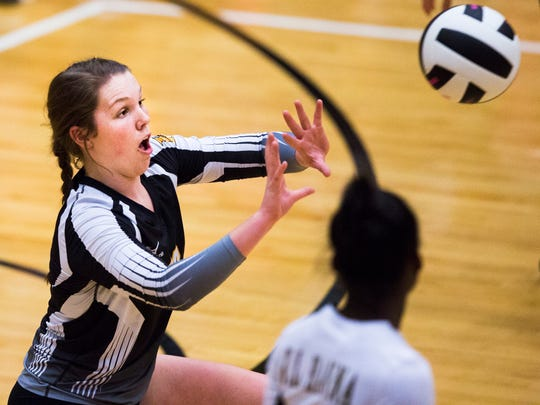 T.L. Hanna's Maddie Bryant sets the ball during the T.L. Hanna vs. J.L. Mann volleyball game on Tuesday.
