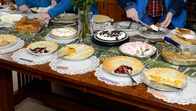 Barb Coyle's dining room table is covered with pies every Thanksgiving morning.