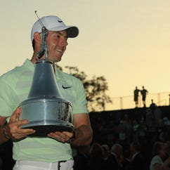 March 18: Rory McIlroy holds the trophy after his victory in the Arnold Palmer Invitational at Bay Hill Club and Lodge in Orlando.
