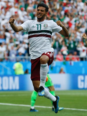 Mexico's Carlos Vela celebrates after scoring the opening goal during the group F match against South Korea.