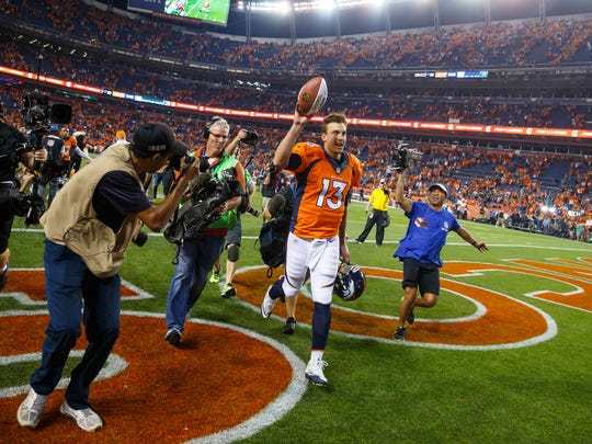 Denver Broncos quarterback Trevor Siemian (13) celebrates following the game against the Carolina Panthers at Sports Authority Field at Mile High.