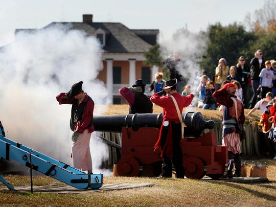 Re-enactors fire canons during the commemoration of the Battle of New Orleans at Chalmette Battlefield in 2011.