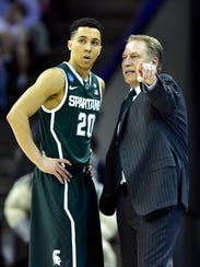 Michigan State coach Tom Izzo talks with veteran guard