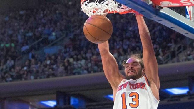Joakim Noah throwing one down during his Knicks debut in preseason game Saturday, Oct. 15, 2016.