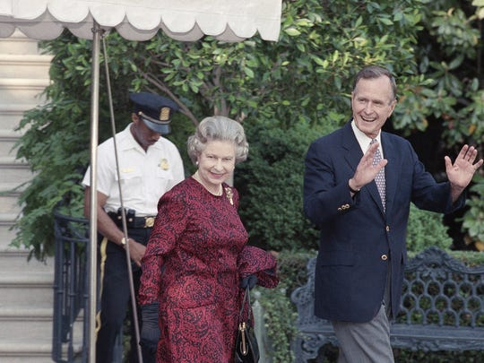 President George H.W. Bush escorts Queen Elizabeth II from the White House to a helicopter enroute to Baltimore to watch her first major league baseball game on Wednesday, May 15, 1991 in Washington. (AP Photo/Doug Mills)