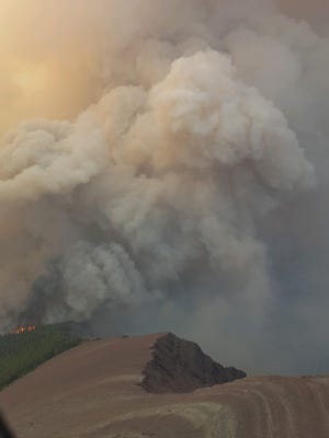 The Boundary fire in northwest Montana kicks up a plume of smoke in August.