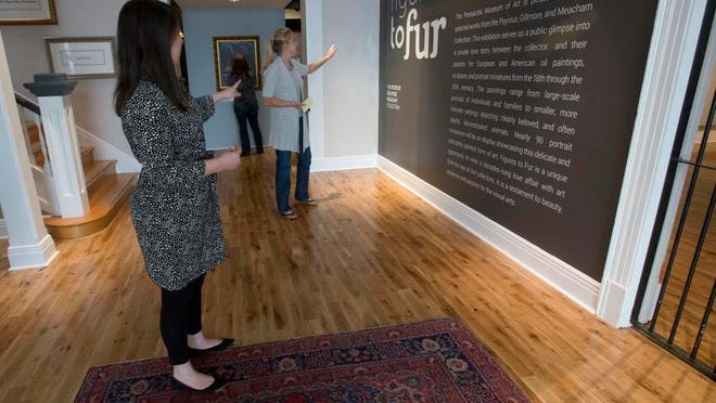 Pensacola Museum of Art Marketing Director Stacy Kendall, left, and Director of Curatorial Affairs Alexis Leader plan for the placement of an upcoming exhibit at the downtown museum Wednesday afternoon.
