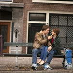 Fellow cancer patients Augustus (Ansel Elgort) and Hazel (Shailene Woodley) make the most of their Make a Wish-like trip to Amsterdam in 'The Fault in Our Stars.'