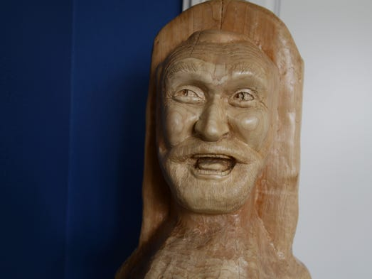 """A wood carving by David Steinberg is displayed in the """"blue room"""" at his home in Silverton on Monday, April 14, 2014. Steinberg creates carvings inspired by family and friends."""