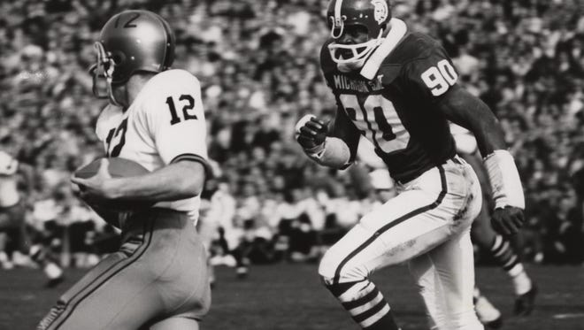 The late George Webster, perhaps the greatest player in MSU football history, chases Purdue quarterback Bob Griese in 1966, a fitting photo considering the reunion of the 1965 team this Saturday at Spartan Stadium. Purdue and Griese went to the Rose Bowl that season, despite a 41-20 loss MSU, because the Spartans had gone the year before and the Big Ten had a no-repeat rule.