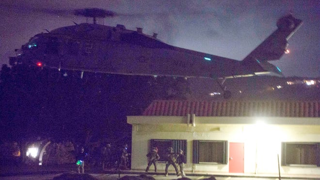 Marines with Maritime Raid Force, 31st Marine Expeditionary Unit, descend from a hovering helicopter by rope into the Governor Ricardo J. Bordallo Complex as part of Realistic Urban Training Exercise at Adelup on Feb. 2, 2017.