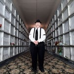 Tom Beckel, president of the Marion Mausoleum Association, walks through the West Wing of the Marion Mausoleum.