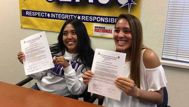 Bloomfield's Kara Watchman, left, and Destiny Walther signed national letters of intent to play basketball for Haskell Indian Nations University.