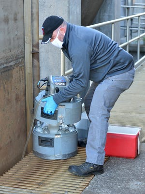 Paul Totleben collects water samples on May 21 from the intake areas of the Erie Wastewater Treatment Plant. They were some of the first samples used to detect COVID-19, the new coronavirus, in Erie's wastewater. Totleben, 53, is the plant's industrial pre-treatment inspector.