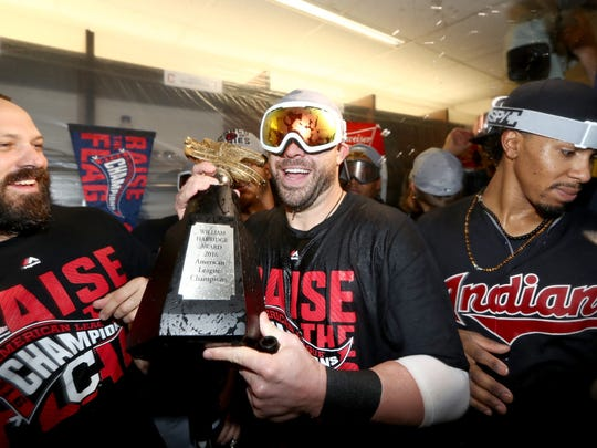 Jason Kipnis #22 of the Cleveland Indians celebrates with his teammates in the locker room after defeating the Toronto Blue Jays with a score of 3 to 0 in game five to win the American League Championship Series at Rogers Centre on October 19, 2016 in Toronto, Canada.