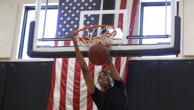 Marvin Bagley III dunks a ball during Arizona Power Basketball Academy club team workout at Gilbert Christian High School on June 6, 2013, when Bagley was with the Arizona Power.