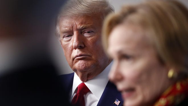 FILE - In this March 31, 2020, file photo President Donald Trump listens as Dr. Deborah Birx, White House coronavirus response coordinator, speaks about the coronavirus in the James Brady Press Briefing Room of the White House in Washington.