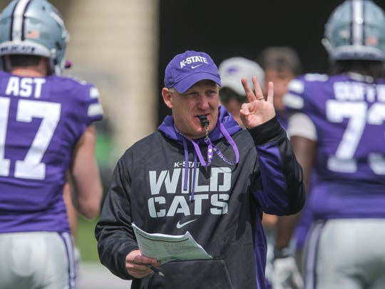 New Kansas State head coach Chris Klieman leads his team through their final NCAA college spring football practice on April 13, 2019, in Manhattan, Kansas. Klieman, who led North Dakota State to four FCS titles the past five seasons, took over when 79-year-old Bill Snyder retired for a second time.