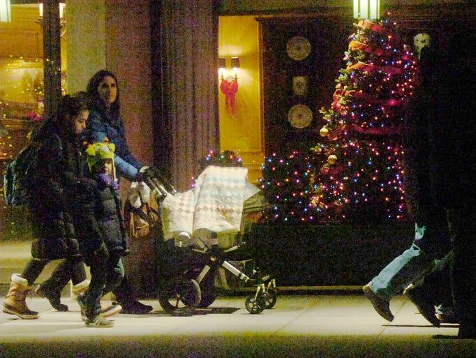 Shoppers walk along sidewalk on Merrill during Ladies