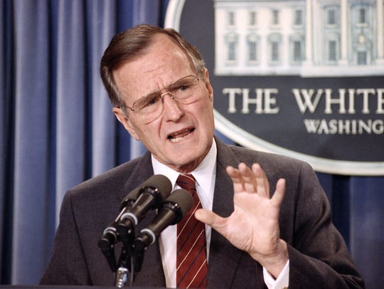President George H.W. Bush speaks during a news conference