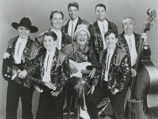 An undated photo shows the multigenerational cast of