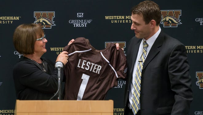 Western Michigan University athletic director Kathy Beauregard presents football coach Tim Lester with a jersey as he was introduced to the media and guests Saturday afternoon.