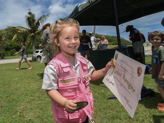 Three-year-old Morgan Mollot smiles after receiving a certificate and junior ranger badge at the War in the Pacific National Historical Park in Asan on April 21, 2018.