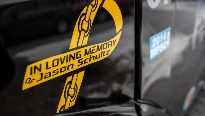 Preferred Towing vehicles donned ribbons during a funeral service for Jason Schultz Wednesday, Jan. 20, 2016 at Ross Bible Church in Port Huron Township.
