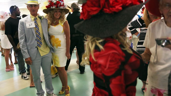 David and Karen East, of Estero, wait for the results of the derby hat contest at the Naples-Fort Myers Greyhound Track in celebration of the Kentucky Derby on May 7, 2016
