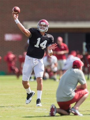 Alabama quarterback Jake Coker (14) works through drills during football practice Aug. 31 at the Thomas-Drew Practice Fields in Tuscaloosa, Ala.