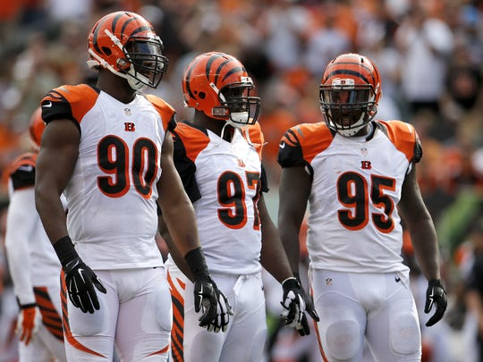 From left: Cincinnati Bengals defensive end Michael Johnson (90), Cincinnati Bengals defensive tackle Geno Atkins (97) and Cincinnati Bengals defensive end Wallace Gilberry (95) line up for the next play in the fourth quarter during the NFL game between the San Diego Chargers and the Cincinnati Bengals, Sunday, Sept. 20, 2015, at Paul Brown Stadium, in Cincinnati, Ohio.