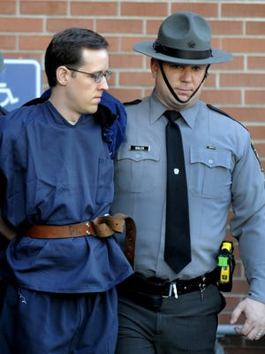 Eric Frein leaves the Pike County, Pa., courthouse after his preliminary hearing Jan. 5, 2015.