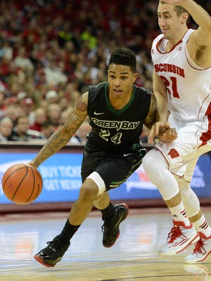 UW-Green Bay's Keifer Sykes (24) drives past Wisconsin's Josh Gasser (21) in the second half during Wednesday night's game at the Kohl Center in Madison. Evan Siegle/Press-Gazette Media