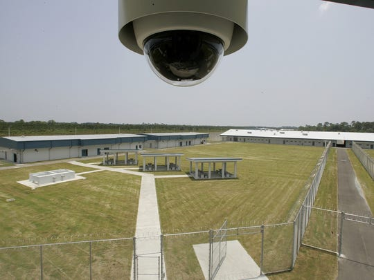 A security camera hangs from the ceiling of the guard tower in the center of the Franklin Correctional Institution