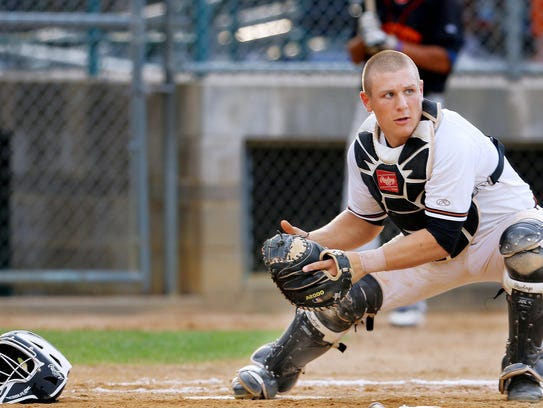 Expess catcher Daulton Varsho touches home plate to