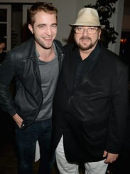 Robert Pattinson, left, poses with director/writer