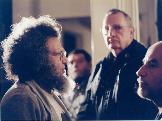 Peter Diamondstone pictured as he was arrested in 1996 at the Statehouse in Montpelier for attempting to join a debate for U.S. House candidates.
