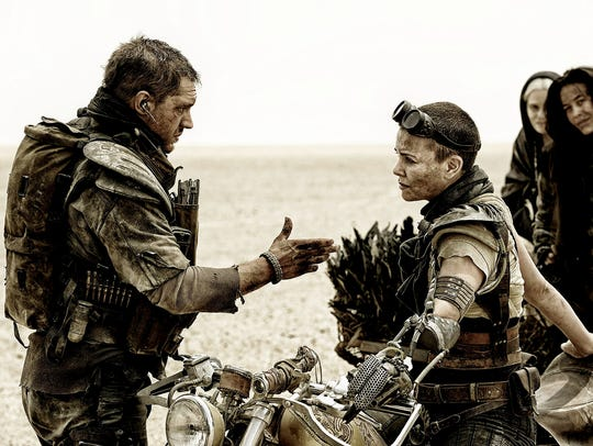 Tom Hardy as Max Rockatansky and Charlize Theron as