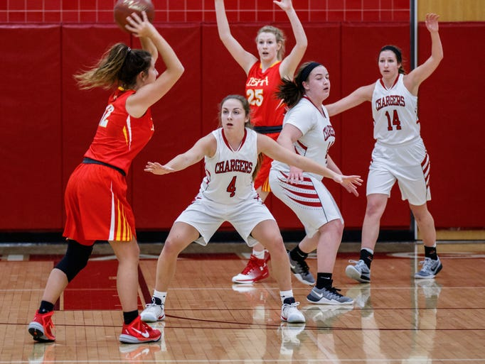 Hamilton senior Macy Williams (4) defends the paint