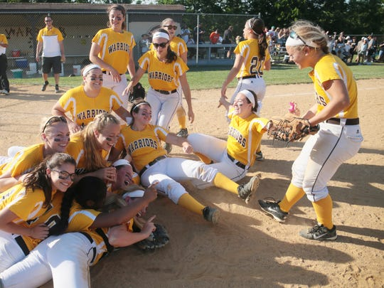Watchung Hills celebrate after defeating Piscataway 6-2 in the North 2 Group IV sectional final in Warren on June 2, 2016.